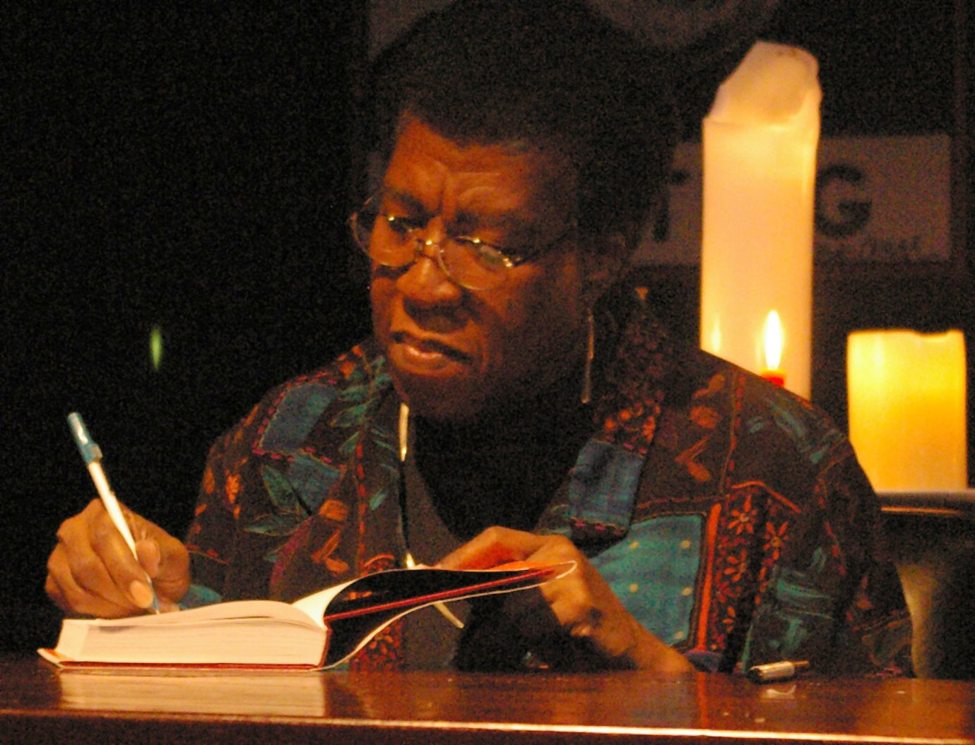 Octavia Butler herself, signing a hardcover copy of a book